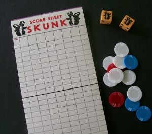 skunk dice, chips and score pad for dice game