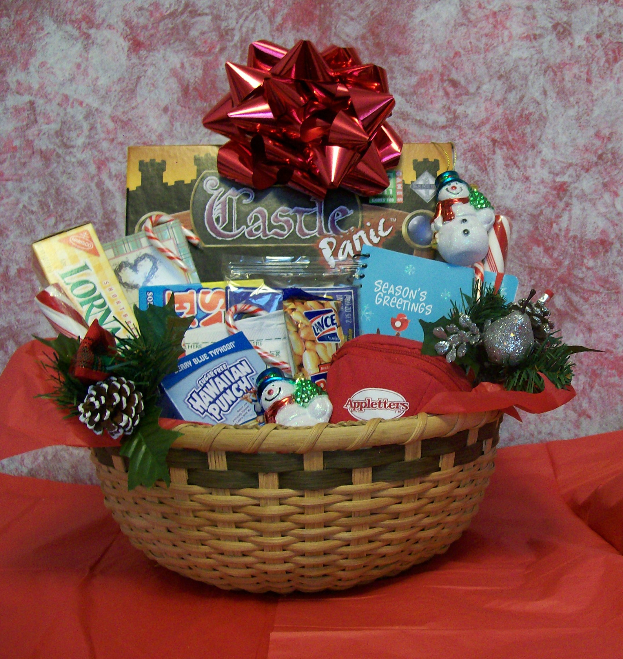Create a christmas fun and games gift basket for family